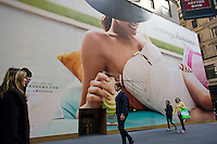 "A construction shed decorate a giant billboard covering the future Tommy Bahama store on Fifth Avenue in New York, seen on Monday, March 26, 2012. The company sells their signature ""island- inspired clothing"" and the store is scheduled to open by the end of 2012.  (© Richard B. Levine)"