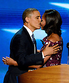 United States President Barack Obama kisses his wife, first lady Michelle Obama, as he arrives to accept his party's nomination for a second term at the 2012 Democratic National Convention in Charlotte, North Carolina on Thursday, September 6, 2012.  .Credit: Ron Sachs / CNP.(RESTRICTION: NO New York or New Jersey Newspapers or newspapers within a 75 mile radius of New York City)