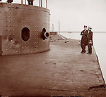 Civil War: James River, Va. Deck and turret of the battle damaged U.S.S. Monitor. It shows marks of enemy fire from the Merrimack (CSS Virginia, dents on turret) James Gibson photographer. She was made famous in the historic Hampton Roads &quot;Battle of the Ironclads Monitor vs Merrimack&quot;. 1862 July