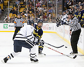 Damon Kipp (UNH - 4), Brendan Ellis (Merrimack - 22), Chris Millea - The Merrimack College Warriors defeated the University of New Hampshire Wildcats 4-1 (EN) in their Hockey East Semi-Final on Friday, March 18, 2011, at TD Garden in Boston, Massachusetts.