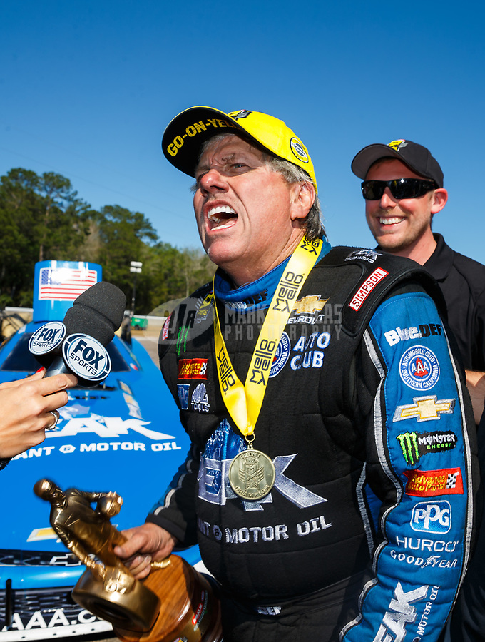 Mar 19, 2017; Gainesville , FL, USA; NHRA funny car driver John Force sings as he celebrates after winning the Gatornationals at Gainesville Raceway. Mandatory Credit: Mark J. Rebilas-USA TODAY Sports