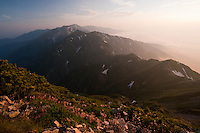 Sunrise from the summit of Mount Goryu lights the North Japan Alps with a soft glow.