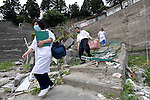 Dr. Sen Hiraizumi poses for a photo outside the Yamada  town Prefectural Hospital in Yamada town, Iwate Prefecture, Japan on  10 June 20011.  .Photographer: Robert GilhoolyDr. Sen Hiraizumi and two nurses, Fumie Ooi and.Etsuko Noda, pass through debris on their way to visiting a patient in Yamada town, Iwate Prefecture, Japan on  10 June 20011. With the prefectural hospital in Yamada badly damaged by the March 11 quake and tsunamis, hospital staff have followed Hiraizumi's lead to take their expertise to those in need..Photographer: Robert Gilhooly