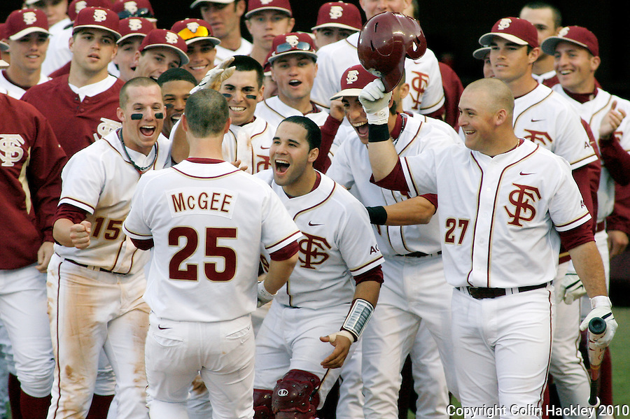 TALLAHASSEE, FL 10-FSU-GA.ST. BASE10 CH20-Florida State's Mike McGee crosses home plate as the Seminoles celebrate him homering and driving two runs in against Georgia State Friday at Dick Howser Stadium in Tallahassee. The Seminoles beat the Panthers 11-3 in the 2010 season opener...COLIN HACKLEY PHOTO