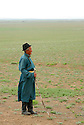 Old man standing on remote plain. Mongolia.