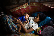 A mother and child in a village devasted by cyclone Nargis near the city of Thanlyin, 70 kms east of Myanmar's main city Yangon, was devastated by cyclone Nargis when it hit the Irrawaddy delta on May 3 2008, killing tens of thousands. But no help has reached this village in days.