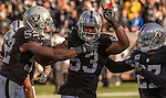 Oakland Raiders defensive end Khalil Mack (52), outside linebacker Malcolm Smith (53) and free safety Reggie Nelson (27) celebrate recovering ball on Saturday, December 24, 2016, at O.co Coliseum in Oakland, California.  The Raiders defeated the Colts 33-25.