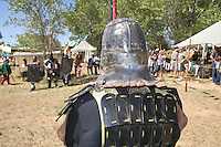 The Renaissance Fair is held each September at the historic museum of El Rancho de Las Golondrinas near Santa Fe and features dancers, kinghts, acrobats and many other performers all celebrating the culture and life style of the Medieval Middle Ages. Knights in home made armor from the Society for Creative Anachronism do battle to win the favor of the King and Queen. Partick Trujillo as Edrick  awaits his challengers as a Lady reads a proclaimation.