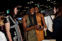 INDIANAPOLIS, IN - APRIL 1, 2011: Sarah Boothe, Chiney Ogwumike and Nnemkadi Ogwumike enjoy the festivities at the Cirque du Salute at the Indianapolis Convention Center at Tourney Town during the NCAA Final Four in Indianapolis, IN on April 1, 2011.