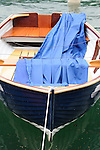 Dark blue boat on Lake Como.