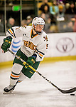 20 January 2017: University of Vermont Catamount Defenseman Rob Hamilton, a Senior from Calgary, Alberta, in first period action against the University of Connecticut Huskies at Gutterson Fieldhouse in Burlington, Vermont. The Catamounts held onto their lead throughout the game to defeat the Huskies 5-4 in Hockey East play. Mandatory Credit: Ed Wolfstein Photo *** RAW (NEF) Image File Available ***