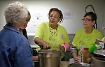 Yvette Richards (center), president of the United Methodist Women Board of Directors, helps prepare food at the Fourth Avenue United Methodist Church in Louisville, Kentucky, on April 24, 2014, the Ubuntu day of service before the United Methodist Women Assembly in Louisville, Kentucky. The church provides food to homeless and underemployed people.