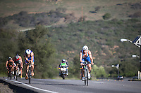 A pack of pro men climb the hills of Camp Pendleton in the Accenture Ironman California 70.3 in Oceanside, CA on March 29, 2014.