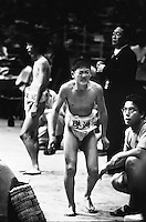 Young Rikishi Sumo wrestlerlimps away from the Dohyo after losing his contest..450 children, aged between 11-14, qualified for  the All Japan Wanpaku Sumo Tournament. The  Ryogoku Kokugikan Stadium, Tokyo, Japan.