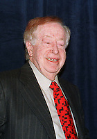 Abe Hirschfeld appears at a press conference called by him where he presented Paula Jones a check for one million dollars to settle her sexual harassment lawsuit against United States President Bill Clinton at the Mayflower Hotel in Washington, DC on 31 October, 1998.<br />