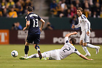Todd Dunivant (2) of the LA Galaxy slides Kyle Nakazawa (13) of the Philadelphia Union and  battle. The LA Galaxy defeated the Philadelphia Union 1-0 at Home Depot Center stadium in Carson, California on  April  2, 2011....