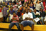 UK's two time basketball national champion Wayne Turner poses with Wells Brown Elementary students  after an academic pep rally, Friday, September 24, 2010.Turner has returned to UK to complete his degree and will graduate in May.  Photo by Theresa | Staff