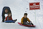 Brian Garrison of Santa Rosa and his two sons, Chandler, 6, and Nate, 2, find enough snow at Squaw Valley on Thanksgiving to get in a few runs of unauthorized sledding. The weather is expected to change for the better for ski buffs and spell the end for now of Northern California's warm days and cool nights.