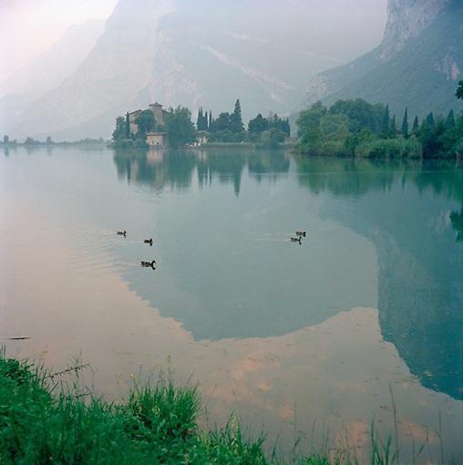Northern Italian Alps reflected in lake