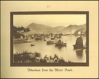 BNPS.co.uk (01202 558833)<br /> Pic: Tooveys/BNPS<br /> <br /> Aberdeen anchorage from the Motor Road on the south of Hong Kong Island.<br /> <br /> A fascinating set of early images of Hong Kong long before it became the metropolis it is today have surfaced. <br /> <br /> The black and white photographs dating to the early 20th century depict a region unrecognisable to what stands today. <br /> <br /> There are several shots of natives walking down packed low-rise streets while a number of others picture primitive sailing boats. <br /> <br /> The collection was compiled by adventurous British photographer Denis H. Hazell, who took each of the 26 postcard-like photos.