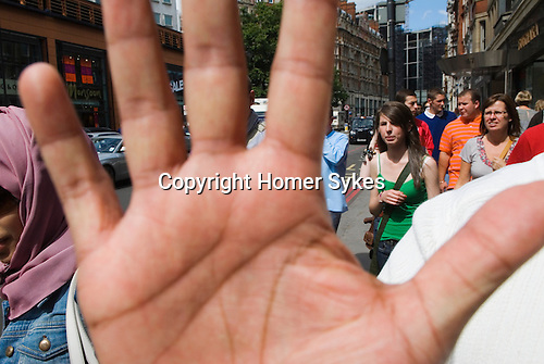 Tourists in Knightsbridge London 2009. Arab man prevents a picture being taken.