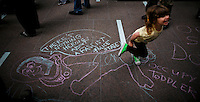 A girl runs over a graffiti during a meeting of Occupy Wall Street members to attend the Spring training season at Zuccotti park in New York, United States. 23/03/2012.  Photo by Eduardo Munoz Alvarez / VIEWpress.