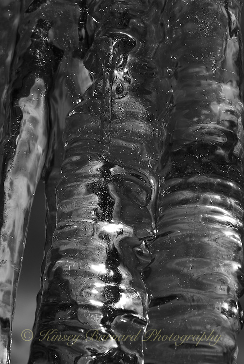 &quot;ICICLES-6&quot;<br /> <br /> The winter icicles that form any place they can find to hang, even eaves create very imaginative works of natural art. One is likely to find these amazing designs most anywhere in a Montana winter.