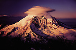 Mt. Rainier with a lenticular cloud cap. The term lenticular comes from being convex, or arc shaped, as these clouds are.