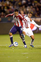 LA Galaxy defender Leonardo battles Chivas USA forward Jesus Padilla. The LA Galaxy defeated Chivas USA 2-0 during the Super Clasico at Home Depot Center stadium in Carson, California Thursday evening April 1, 2010.  .