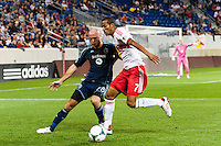 Aurelien Collin (78) of Sporting Kansas City battles Roy Miller (7) of the New York Red Bulls for the ball. Sporting Kansas City defeated the New York Red Bulls 1-0 during a Major League Soccer (MLS) match at Red Bull Arena in Harrison, NJ, on April 17, 2013.