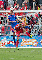 Toronto, Ontario - April 12, 2014: Colorado Rapids defender Shane O'Neill #27 and Toronto FC forward Gilberto #9 in action during the 2nd half in a game between the Colorado Rapids and Toronto FC at BMO Field in Toronto.<br /> Colorado Rapids won 1-0.