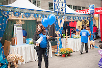 New York Life insurance company joins other companies in promoting their financial services and products to Indian-Americans at the Deepavali street fair in New York on Sunday, October 2, 2016.  (© Richard B. Levine)