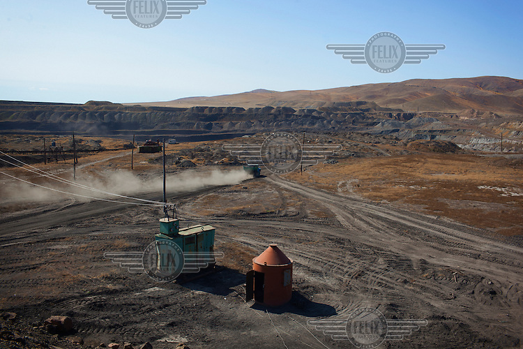 Mining at the Sharyngol open cast coal mine.  The mine became operational in 1965 but since the withdrawl of Soviet support in the 1990's the mine runs at only about 25% capacity.