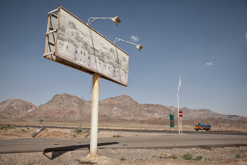 A truck passes the desert road of Central Iran, near Yazd.