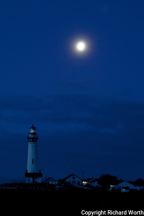 The moon shines down on the Pigeon Point Lighthouse and Hostel on the California coast south of San Francisco.