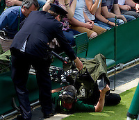 Ambience - Camera man falls over..Tennis - Grand Slam - The Championships Wimbledon - AELTC - The All England Club - London - Mon June 25th 2012. .© AMN Images, 30, Cleveland Street, London, W1T 4JD.Tel - +44 20 7907 6387.mfrey@advantagemedianet.com.www.amnimages.photoshelter.com.www.advantagemedianet.com.www.tennishead.net
