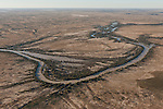 Aerial - The Warburton River nestled in the Sturt Stoney Desert - part of the Cowarie cattle Station.