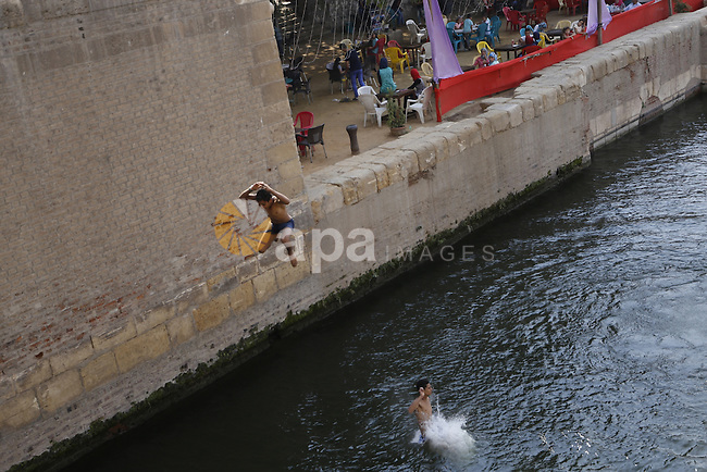 Egyptians swim on the second day of Eid al-Adha or the feast of sacrifice, at a park in cairo, on Sep. 13, 2016. Muslims across the world are celebrating the annual festival of Eid al-Adha, or the Festival of Sacrifice, which marks the end of the Hajj pilgrimage to Mecca and in commemoration of Prophet Abraham's readiness to sacrifice his son to show obedience to God. Photo by Amr Sayed