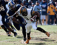 Pitt defensive end Brandon Lindsey brings down WVU wide receiver Jock Sanders (9). The WVU Mountaineers defeated the Pitt Panthers 35-10 at Heinz Field, Pittsburgh, Pennsylvania on November 26, 2010.