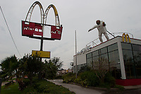 The American flag on an astronaut figurine atop a McDonalds Restaurant in Seabrook, TX after Hurricane Ike tore through the area in 2008.