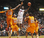 Mississippi forward Terrance Henry (1) shoots between Tennessee's Scotty Hopson (32), Tennessee's Tobias Harris (12), Tennessee's John Fields (25), and Tennessee's Trae Golden (11) at the C.M. &quot;Tad&quot; Smith Coliseum in Oxford, Miss. on Satursday, January 29, 2011. Tennessee won 74-57. (AP Photo/Oxford Eagle, Bruce Newman)