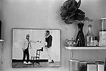 Patrick Procktor artist London 1969. Photograph on wall of kitchen David Hockney + proctor. His kitchen in his Manchester Street flat London.