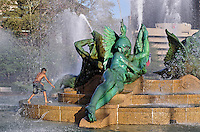 Boy playing in Swann Fountain in Logan's Circle, Philadelphia, Pennsylvania