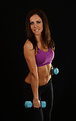 Stock photo of physically fit Hispanic woman doing training
