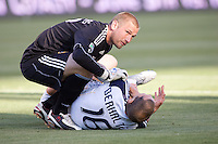 LA Galaxy Goal Keeper Josh Saunders (12) checks on injured teammate Gregg Berhalter (16). The LA Galaxy defeated Boca Juniors 1-0 at Home Depot Center stadium in Carson, California on Sunday May 23, 2010.  .