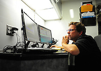 Jan. 16, 2012; Jupiter, FL, USA: NHRA funny car crew chief Del Worsham reads engine data on a computer in the teams hauler during testing at the PRO Winter Warmup at Palm Beach International Raceway. Mandatory Credit: Mark J. Rebilas-