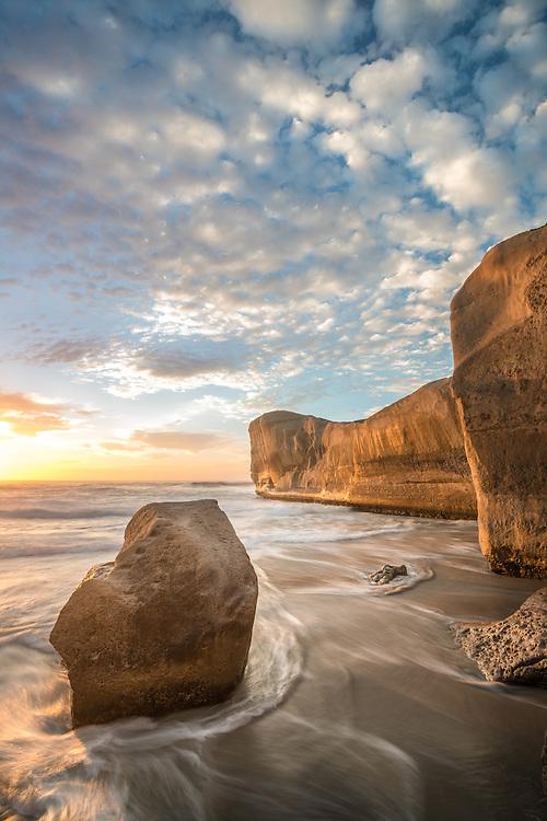Golden morning light on the beautiful headland at Tunnel Beach. Dunedin, New Zealand - stock photo, canvas, fine art print