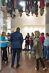 Melville, New York, USA. 24th January 2017. At left from behind in suit, GARRETT ARMWOOD, Long Island Regional Director for U.S. Senator Chuck Schumer of New York; speaks with TWWLI members, including at left in blue shirt, TWWLI admin SUE MOLLER, of Merrick, when 15 members of Together We Will Long Island stop by Democrat Schumer's Melville office to share their concerns, especially about Trump's Cabinet appointees, #SwampCabinet. This Stop Trump Tuesday, #StopTrumpTuesday, event was part of nationwide political movement. They spoke in hall outside office due to limited space. Members of organizations such as MoveOn, Indivisible, and TWW plan to visit their Senators' offices each Tuesday duringTrump's first 100 days of presidency.