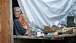 A man sits in his temporary shelter in Tacloban, a city in the Philippines province of Leyte that was hit hard by Typhoon Haiyan in November 2013. The storm was known locally as Yolanda. The ACT Alliance has been active here and in affected communities throughout the region helping survivors to rebuild their homes and recover their livelihoods.