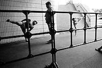 Young Rikishi Sumo competitors prepare for their contest..450 children, aged between 11-14, qualified for  the All Japan Wanpaku Sumo Tournament. The  Ryogoku Kokugikan Stadium, Tokyo, Japan.